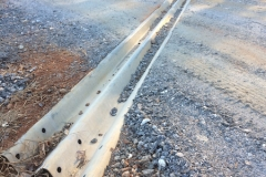 "Excellent used twenty inch ( 20"" Thrie Beam) highway guardrail panel goes to work as a powerful, effective road water runoff diverter. Keeps gravel road from eroding. Keeps runoff water much cleaner."