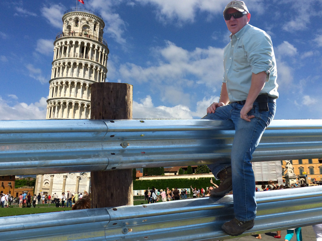 Tom at Pisa guardrail helping to hold it up