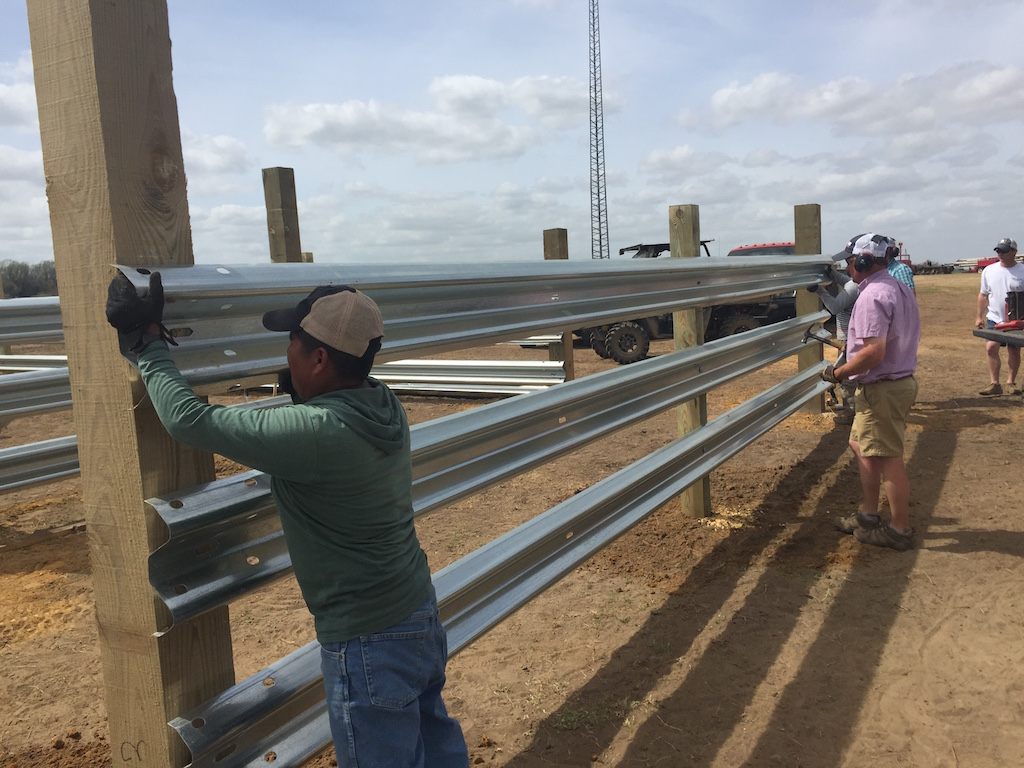 Workers easily install LiveStock Steel for feedlots